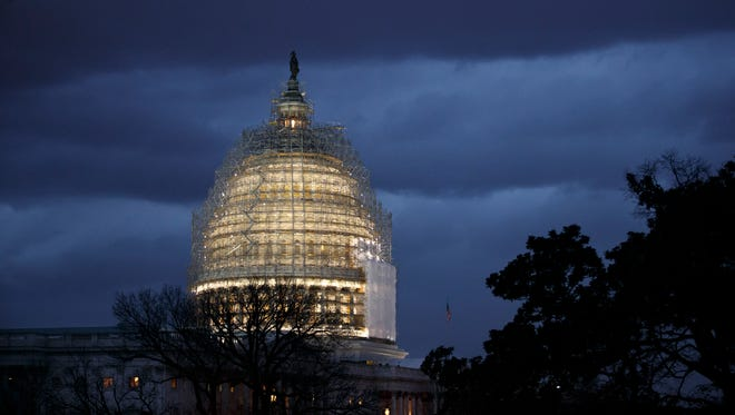 The Capitol is seen at dusk in Washington on Dec. 1, 2014.