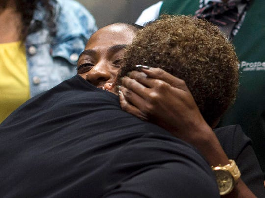 Charnee James hugs her grandmother, Deborah Gullatt,