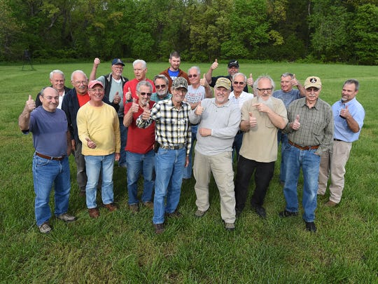 Members of Burgers Brats & Propwash, a group of area pilots, give Jim Davis, front with checkered shirt, a thumbs up the day before his cross-country flight.