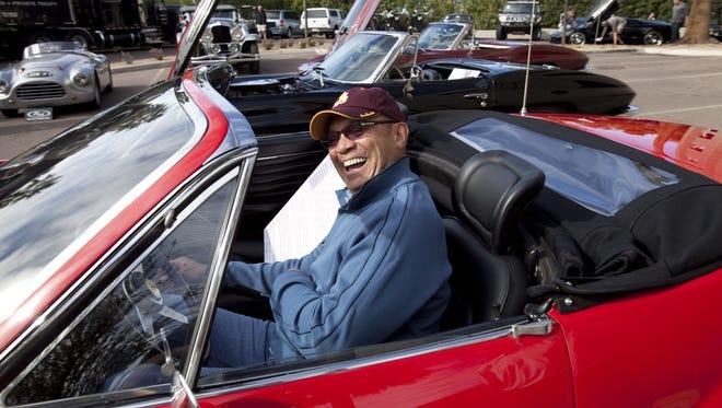 Baseball legend Reggie Jackson sitting in a 1973 Ferrari 365.