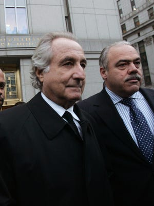 File photo shows Ponzi scheme architect Bernard Madoff leaving Manhattan federal court in New York City after a 2009 bail hearing.