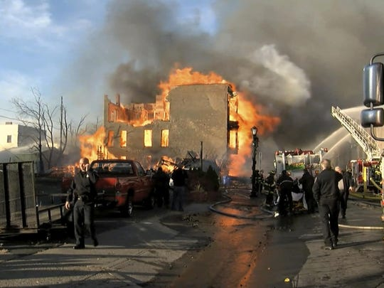 In this image taken from video provided by WRGB-TV, Albany, a fire burns Thursday, Nov. 30, 2017, in downtown Cohoes.