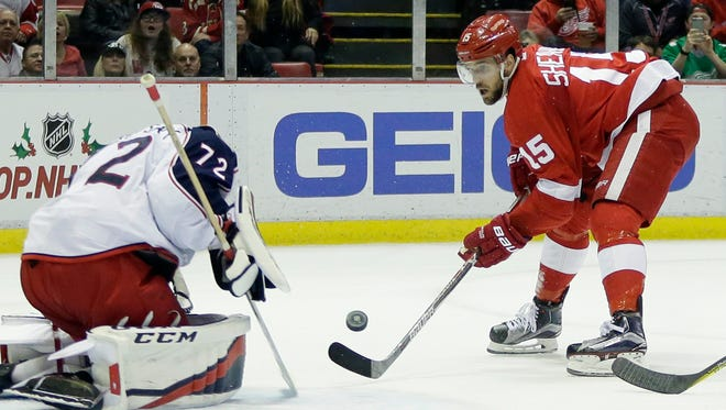 Red Wings center Riley Sheahan (15) shoots against Blue Jackets goalie Sergei Bobrovsky (72) during the second period Friday at Joe Louis Arena.