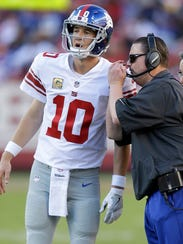 New York Giants quarterback Eli Manning (10) talks with head coach Ben McAdoo during the second half of an NFL football game against the San Francisco 49ers in Santa Clara, Calif., Sunday, Nov. 12, 2017. (AP Photo/Ben Margot)