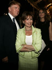 Donald Trump poses with Jeanine Pirro as they enter