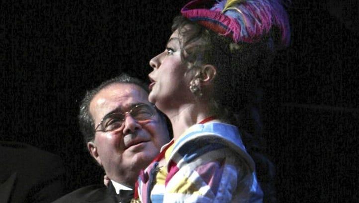 Justice Antonin Scalia with opera singer Lyubov Petrova in 2009 at The Kennedy Center in Washington.