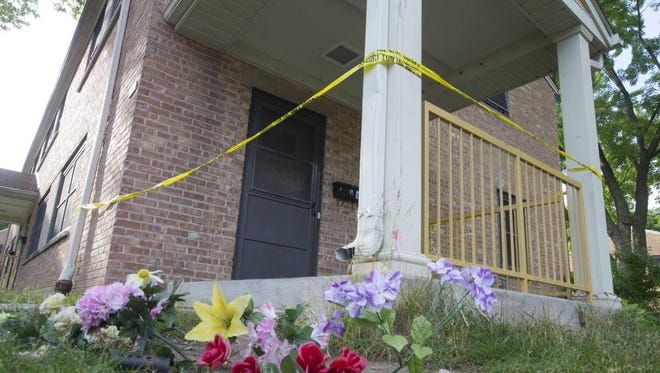 Police tape marks the scene where 13-year old Giovonnie G. Cameron was shot and killed near Lincoln Park in Milwaukee on July 8.