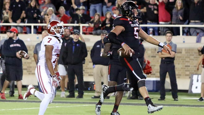 Texas Tech quarterback Patrick Mahomes (5) made history Saturday, despite the Red Raiders' loss.