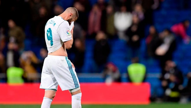Real Madrid forward Karim Benzema wipes his face at the end of the Spanish 'Copa del Rey' (King's cup) quarterfinal second leg football match between Real Madrid CF and CD Leganes at the Santiago Bernabeu Stadium.
