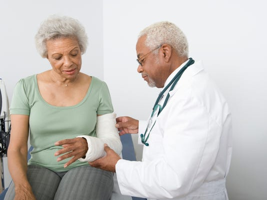 Doctor Checking Patients Fractured Hand