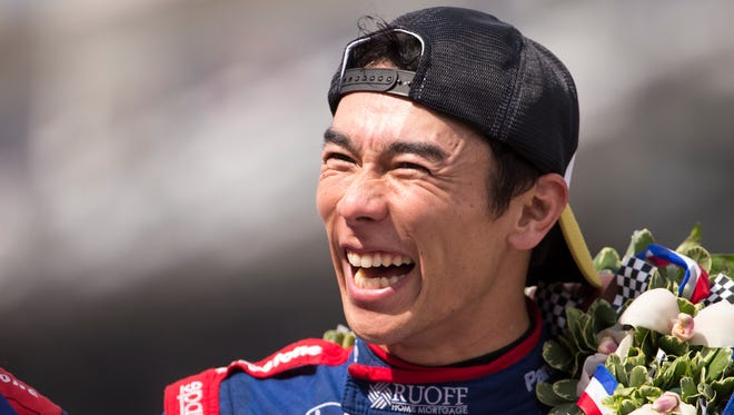 An ebullient Takuma Sato is all smiles after his win in the Indianapolis 500 after a late race pass of Helio Castroneves, at Indianapolis Motor Speedway, Sunday, May 28, 2017.