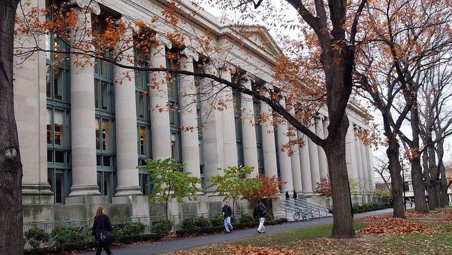 Students walk through the Harvard Law School area on the campus of Harvard University.