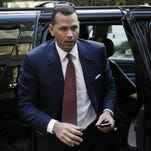 A-Rod arrives at MLB head- quarters Tuesday.