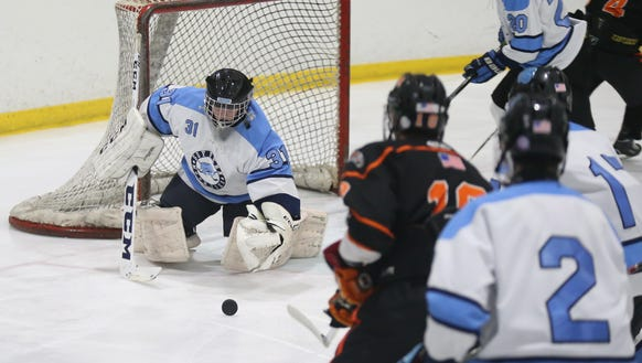 Suffern goalie Mike Halper (31) pulls in a rebound