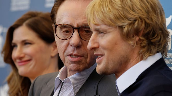 """From left, actress Kathryn Hahn, director Peter Bogdanovich, and actor Owen Wilson pose during the photo call for the movie """"She's Funny That Way"""" at the 71st edition of the Venice Film Festival in Venice, Italy, Friday, Aug. 29, 2014."""