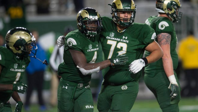 CSU receiver Michael Gallup celebrates a touchdown with lineman Nicho Garcia during the Rams' 44-42 win last Saturday over Nevada at Colorado State University Stadium.