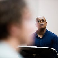 Music Director Teddy Abrams conducts the University of Louisville Chamber Choir during rehearsal for Mass, Louisville Orchestra's productions of Leonard Bernstein's show.