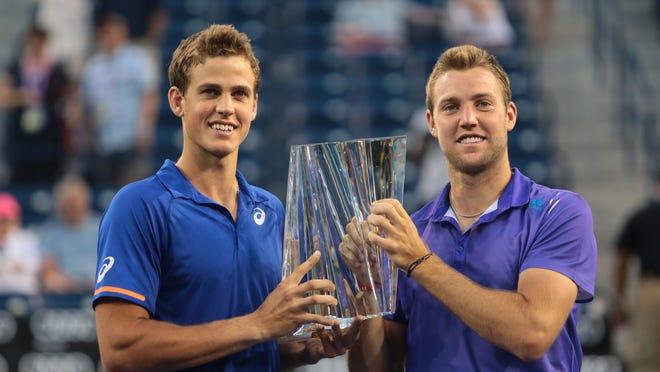 Canadian Vasek Pospisil, left, and American Jack Sock beat the Italian duo of Simone Bolelli and Fabio Fognini for the BNP Paribas Open men's doubles title on Saturday.