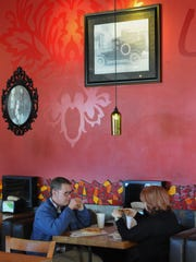 Diners enjoy lunch recently at RedBrick Pizza in Ventura.