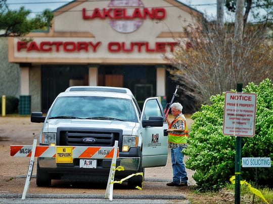 In this file photo surveyors with the Memphis based firm A2H work near the remains of the Lakeland Factory Outlet Mall where multiple plans have failed to bear fruit.