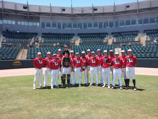 Members of the Next Level Baseball 18U team pose for pictures after a game at the Prospect Wire national championships in Mesa, Ariz., last week.
