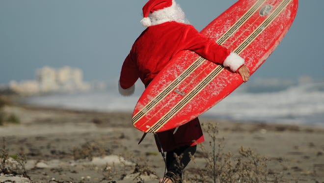 The Surfing Santas event on Christmas Eve in Cocoa Beach is expected to attract over 4,000 people this year.