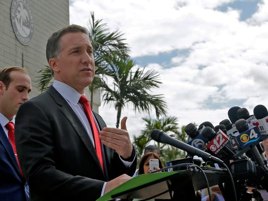 Palm Beach County State attorney Dave Aronberg talks to reporters during a news conference outside the Palm Beach County courthouse, Friday, Oct. 27, 2017, in Palm Beach Gardens, Fla. Golfer Tiger Woods pleaded guilty to reckless driving and agreed to enter a diversion program Friday, five months after he was found passed out in his Mercedes with prescription drugs and marijuana in his system.  (AP Photo/Alan Diaz)