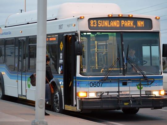 A woman boards a bus in Sunland Park, a city along the U.S.-Mexico border next to Ciudad Juárez and El Paso.