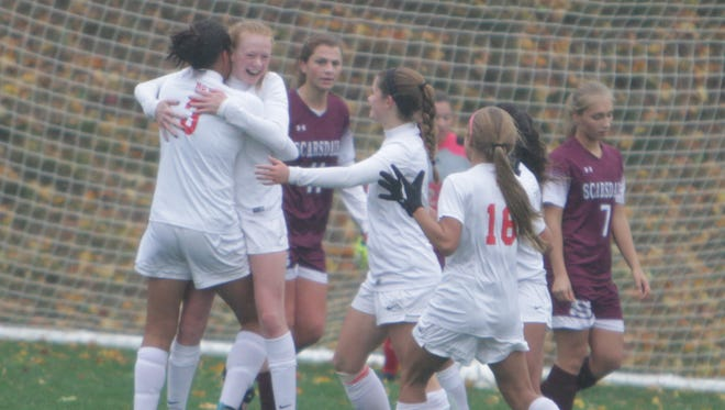 North Rockland celebrates after a goal scored by Kelly Brady during a Section 1 girls soccer Class AA first round game against Scarsdale at North Rockland High School on Saturday, Oct. 22nd, 2016. North Rockland won 1-0.