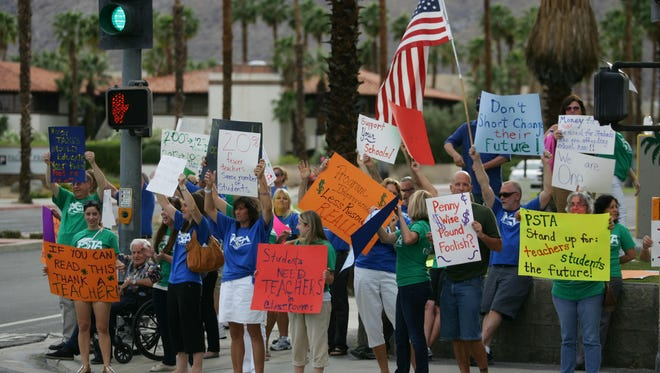 In this Desert Sun file photo, Palm Springs Unified teachers rally during a similar pay dispute in April 2012. Richard Lui The Desert Sun Teachers rally outside the Palm Springs Unified School District Administration - Education Center to show solidarity before a school board meeting on Tuesday, April 24, 2012. The union and the district are negotiating next years contract.  (Richard Lui The Desert Sun)