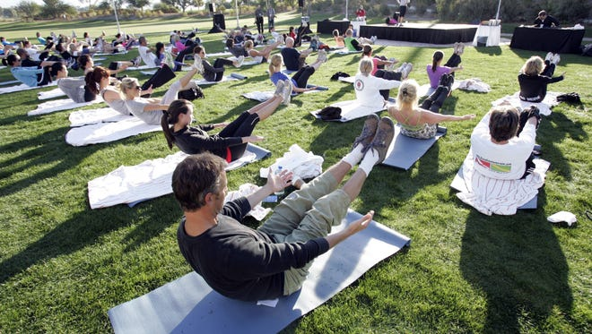 The first ever Palm Springs International Health & Fitness Festival will feature yoga on the tarmac. Festival will be held Nov. 13 to 15. at the Palm Springs Air Museum.