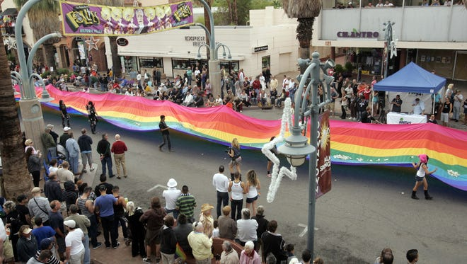 A 600-ft rainbow flag is marched down the street on Sunday, November 6, during the Greater Palm Springs Pride 2011 Pride Parade in Palm Springs, Calif. This year's parade steps off at 10 a.m. on Palm Canyon Drive.