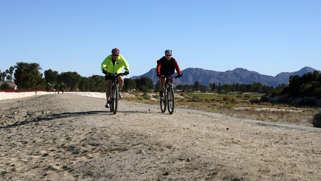 Two men ride bicycles on the Butler-Abrams Trail.
