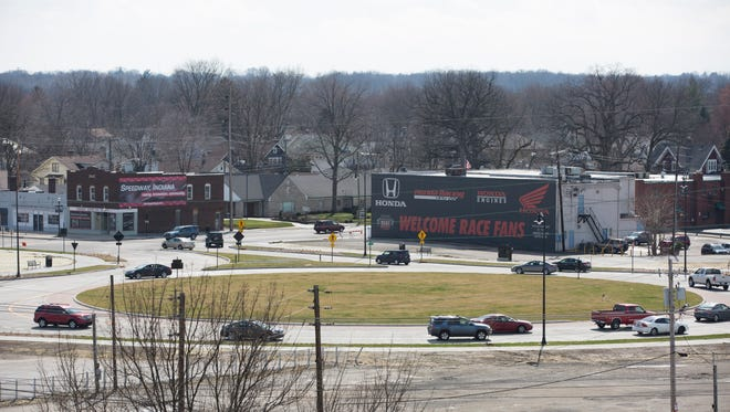 Traffic makes its way through the new Speedway roundabout at 16th Street, Main Street and Crawfordsville Road on April 2, 2015. The roundabout, located just west of Turn One at the Indianapolis Motor Speedway, is meant to ease traffic congestion and reduce accidents. However, as part of the road changes, Georgetown Road now comes to a dead end just north of 16th Street.