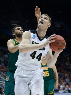 Purdue's Isaac Haas drives past Vermont's Payton Henson during the first half of an NCAA college basketball tournament first round game Thursday, March 16, 2017, in Milwaukee. (AP Photo/Kiichiro Sato)