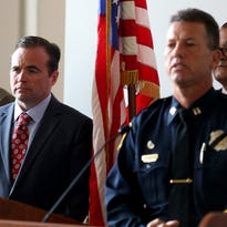 Mayor John Cranley speaks during Tuesday's press conference. Behind him is City Manager Harry Black.