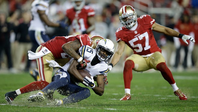 SANTA CLARA, CA - DECEMBER 20:  Wide receiver Dontrelle Inman #15 of the San Diego Chargers is tackled after a catch by cornerback Perrish Cox #20 of the San Francisco 49ers in the fourth quarter at Levi's Stadium on December 20, 2014 in Santa Clara, California.  (Photo by Ezra Shaw/Getty Images)