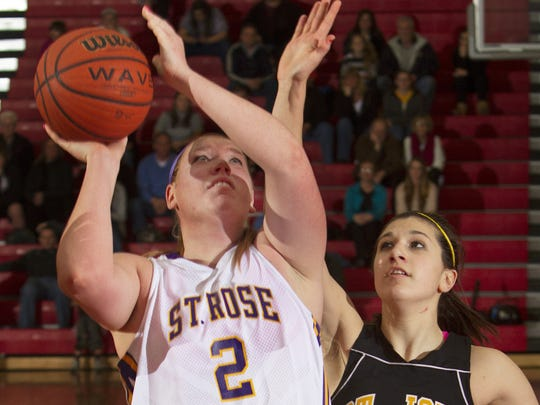 St Rose's Samantha Clark goes up with a shot against