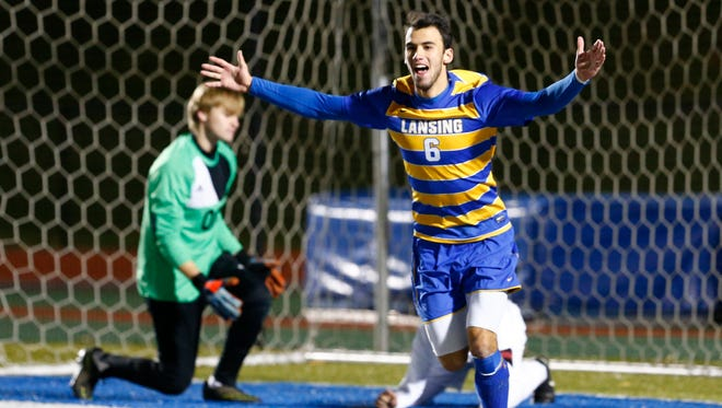 Lansing's Taylor Overton celebrates his goal against Pierson/Bridgehampton during Saturday's Class C state semifinal at Middletown High School on November 11, 2017.