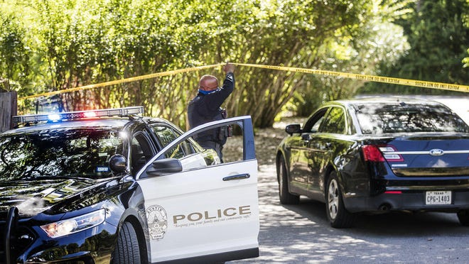 Austin police officers investigate the site where a body was found July 29. Under the proposed city budget from City Manager Spencer Cronk, the Police Department's overall budget next fiscal year would be roughly the same as last year, at $440 million.
