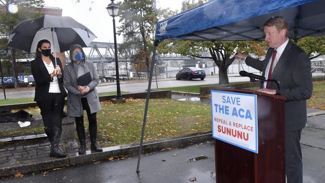 Democratic gubernatorial candidate Dan Feltes holds a press conference Tuesday in Portsmouth's Prescott Park, calling for the Affordable Care Act to be preserved. Stefany Shaheen, left, and Laurie McCray also spoke of the importance of health care and how it relates to their families.