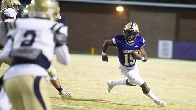 Jontavis Curry of ARC rushes for the Musketeers at the high school football game between ARC and Brantley County on November 27, 2020 in Augusta, Ga.