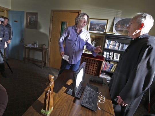 """Director Michael O. Sajbel (center) speaks with actor Lance Henriksen late last week on the set of the film """"Wraith"""" at the Mount Tabor Center in Menasha."""