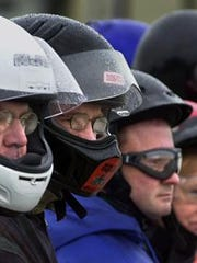 Motorcycle helmet law illustration.