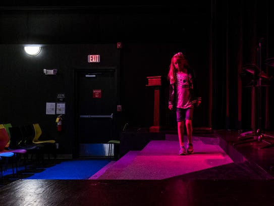 Charlotte Evans, 10, explores the stage of Rinehart
