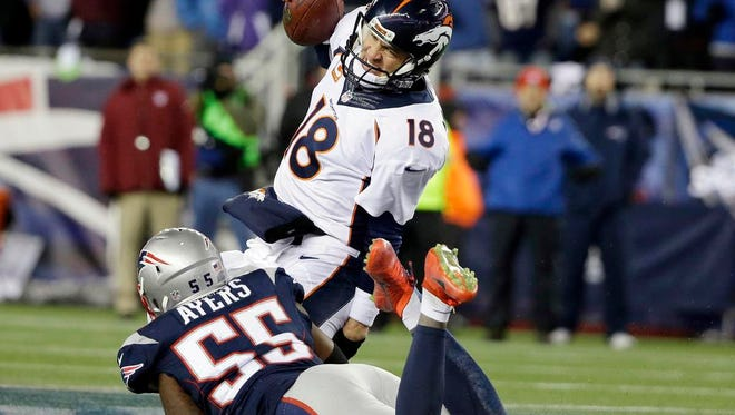 Patriots linebacker Akeem Ayers sacks Broncos quarterback Peyton Manning in the first half on Sunday at Foxborough, Mass.