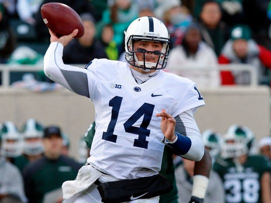 Penn State quarterback Christian Hackenberg throws a pass during the first quarter of an NCAA college football game against Michigan State, Saturday, Nov. 28, 2015, in East Lansing, Mich.
