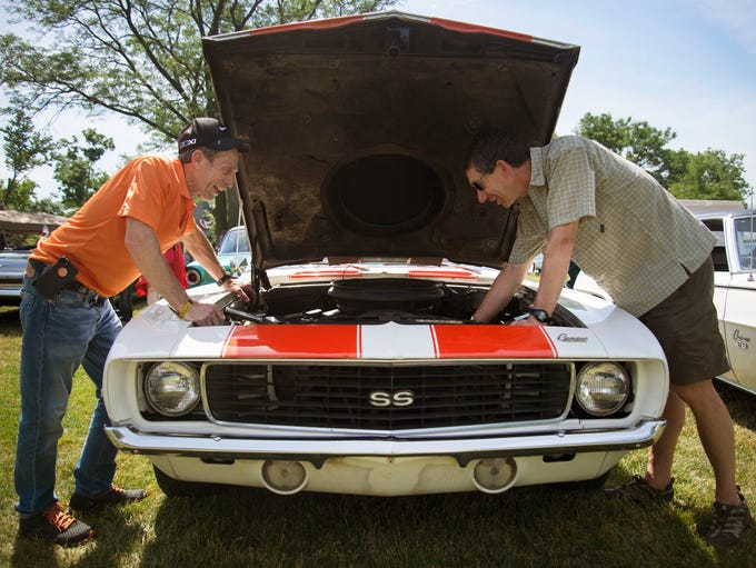 Steven Rinke of Clinton Township, left,  gets his Camaro