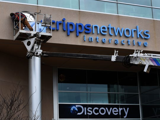 Signs are changed March 7, 2018, with the formal takeover of Knoxville-based Scripps Networks Interactive by Discovery Communications.