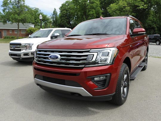 The 2018 Ford Expedition XLT, right, and F-150 King